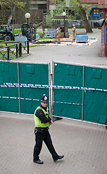 © Licensed to London News Pictures. 24/04/2018. Salisbury, UK.  A policeman walks past a cordon as members of the armed forces remove contaminated soil from the area at the Maltings where a bench was earlier removed as the cleanup operation begins in Salisbury. Former Russian Spy Sergei Skripal and his daughter Yulia were poisoned using a nerve agent in the city last month. Experts have warned that 'Toxic levels' of the nerve agent novichok could still be present at hot spots around the city. Photo credit: Peter Macdiarmid/LNP