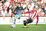 Sheffield Wednesday Midfielder Ross Wallace beats off a challenge from Brentford Defender Jake Bidwell during the Sky Bet Championship match between Brentford and Sheffield Wednesday at Griffin Park, London, England on 26 September 2015. Photo by Phil Duncan.