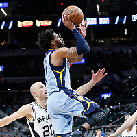 04 April 2017: Memphis Grizzlies guard Mike Conley (11) goes for the jump shot past San Antonio Spurs guard Manu Ginobili (20) and San Antonio Spurs center Pau Gasol (16) during the San Antonio Spurs 95-89 OT victory over the Memphis Grizzlies, at the AT&T Center, San Antonio, Texas, USA.