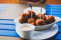"""Conch """"konk"""" Fritters at Compass Point Restaurant, Nassau, Bahamas."""