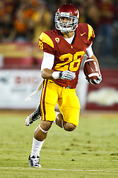September 11, 2010; Los Angeles, CA, USA;  Southern California Trojans running back Dillon Baxter (28) rushes up field against the Virginia Cavaliers during the first quarter at the Los Angeles Memorial Coliseum. USC defeated Virginia 17-14.