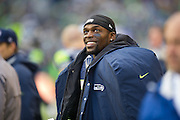 Seattle Seahawks running back, Robert Turbin watches a defensive replay on the jumbotron with enjoyment. Photo by John Lill