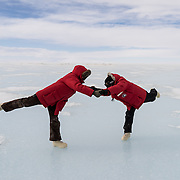 Laura and Amanda ice dancing on the sea ice, near Ferrar Glacier, Antarctica