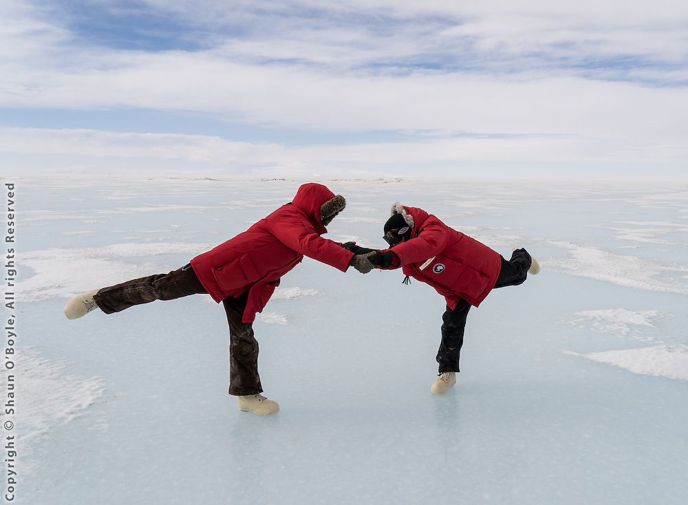 Laura and Amanda ice dancing on the sea ice, near Ferrar Glacier, Antarctica