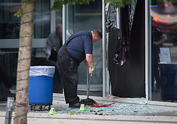 "A worker sweeps up blood covered glass after a female stunt driver working on the movie ""Deadpool 2"" died after a crash on set, in Vancouver, BC, Canada, on Monday August 14, 2017. Vancouver police say the driver was on a motorcycle when the crash occurred on the movie set on Monday morning. Photo by Darryl Dyck/CP/ABACAPRESS.COM"