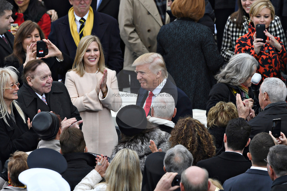 President-elect Donald Trump smiles as he arrives to be sworn-in as the 45th President during the Presidential Inaugural on Capitol Hill January 20, 2017 in Washington, DC.