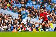 Manchester City Women forward Lee Geum-min (17) and Manchester United Women forward Kirsty Hanson (18) during the FA Women's Super League match between Manchester City Women and Manchester United Women at the Sport City Academy Stadium, Manchester, United Kingdom on 7 September 2019.