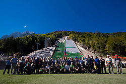 Group photo of Ski jumpers and workers at media day of Slovenian Ski jumping team during construction of two new ski jumping hills HS 135 and HS 105, on September 18, 2012 in Planica, Slovenia. (Photo By Vid Ponikvar / Sportida)