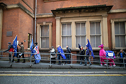 © Licensed to London News Pictures. 26/01/2019. Manchester, UK. Two men dressed as a pink unicorn amongst demonstrators arriving at the Mechanics Institute . A cross party demonstration by hundreds of supporters of a People's Vote on Britain's membership of the EU is held in St Peters Square , followed by a march to the Mechanics Institute and rally of supporters . Photo credit: Joel Goodman/LNP