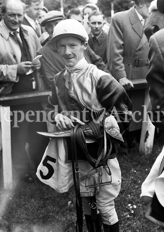 R1604<br /> Jockey  P. O'Mahoney pictured at the races, location unknown, June 5 1958.<br /> (Part of the Independent Newspapers Ireland/NLI collection.)