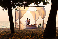 A young couple and a romantic beach setting in southern Vietnam.