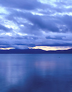 Sunrise as seen from the west shore of Lake Tahoe on a cold winter morning.