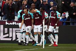 West Ham United's Marko Arnautovic celebrates scoring the opening goal with team mates during the Premier League match at the London Stadium.