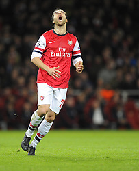 Arsenal's Mathieu Flamini cuts a frustrated figure - Photo mandatory by-line: Joe Meredith/JMP - Tel: Mobile: 07966 386802 19/02/2014 - SPORT - FOOTBALL - London - Emirates Stadium - Arsenal v Bayern Munich - Champions League - Last 16 - First Leg