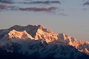 Sunrise over the Kangchenjunga range from the Singalila Ridge, Nepal/India border.