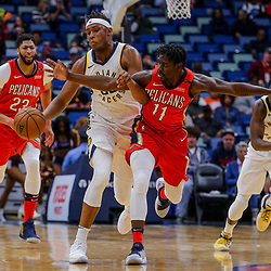 Mar 21, 2018; New Orleans, LA, USA; New Orleans Pelicans guard Jrue Holiday (11) fouls Indiana Pacers center Myles Turner (33) during the first quarter at the Smoothie King Center. Mandatory Credit: Derick E. Hingle-USA TODAY Sports