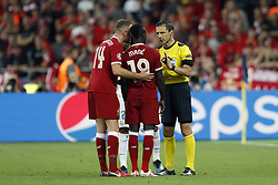 (L-R) Jordan Henderson of Liverpool FC, Sadio Mane of Liverpool FC, referee Milorad Mazic during the UEFA Champions League final between Real Madrid and Liverpool on May 26, 2018 at NSC Olimpiyskiy Stadium in Kyiv, Ukraine