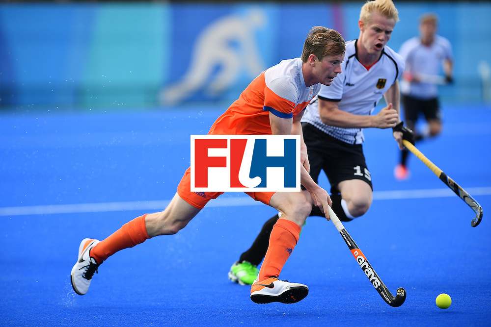 Netherlands' Seve Van Ass (L) and Germany's Tom Grambusch vie during the mens's field hockey Germany vs Netherlands match of the Rio 2016 Olympics Games at the Olympic Hockey Centre in Rio de Janeiro on August, 12 2016. / AFP / Carl DE SOUZA        (Photo credit should read CARL DE SOUZA/AFP/Getty Images)