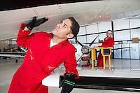 Aeronautical engineers working in airplane hangar