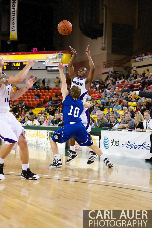 November 27th, 2010:  Anchorage, Alaska - Weber State senior guard Lindsey Hughey (15) passes over the Drake defense in the Wildcat's 82-81 victory over the Drake Bulldogs in the third place game of the Great Alaska Shootout.
