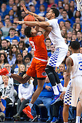 Kentucky forward Skal Labissiere, right, contests a shot by Florida forward Devin Robinson in the first half.<br /> <br /> The University of Kentucky hosted the University of Florida, Saturday, Feb. 06, 2016 at Rupp Arena in Lexington .