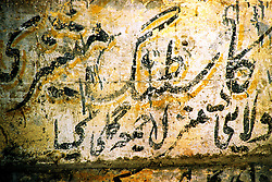 Pakistan, Karachi, 2004. Urdu script becomes part of a wall in the dilapidated center of Karachi's famous Sadaar Bazaar.