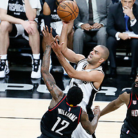 01 May 2017: San Antonio Spurs guard Tony Parker (9) goes for the floater shot past Houston Rockets guard James Harden (13) and Houston Rockets guard Lou Williams (12) during the Houston Rockets 126-99 victory over the San Antonio Spurs, in game 1 of the Western Conference Semi Finals, at the AT&T Center, San Antonio, Texas, USA.