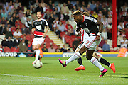 Nottingham Forest forward Britt Assombalonga (9) shot on goal during the EFL Sky Bet Championship match between Brentford and Nottingham Forest at Griffin Park, London, England on 16 August 2016. Photo by Matthew Redman.