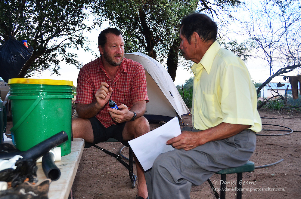 Demonstrating a Sawyer water filter in Isosog