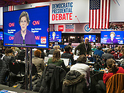 14 JANUARY 2020 - DES MOINES, IOWA: Journalist watch the debate on flat screen TVs in the media work room during the Democratic debate at the CNN Democratic Presidential Debate on the campus of Drake University in Des Moines. This is the last debate before the Iowa Caucuses on Feb. 3.    PHOTO BY JACK KURTZ