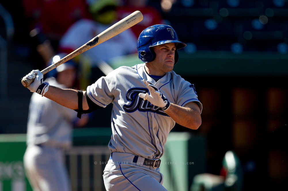 Jimmy Cesario (9) of the Tulsa Drillers follows through his swing during a game against the Springfield Cardinals at Hammons Field on September 9, 2012 in Springfield, Missouri. (David Welker/Four Seam Images)