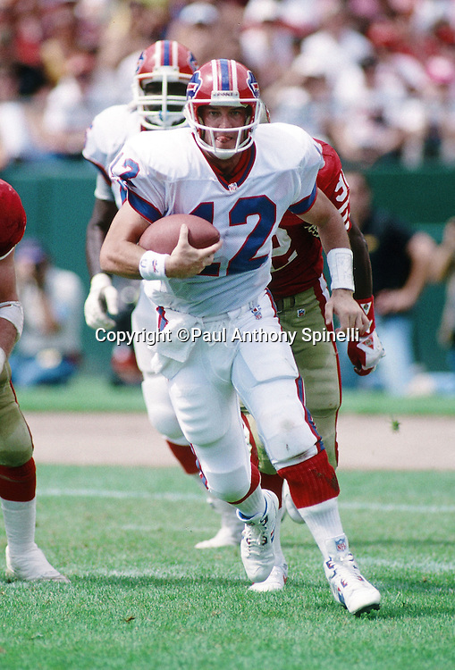 Buffalo Bills quarterback Jim Kelly (12) runs the ball during the NFL preseason football game against the San Francisco 49ers on Sept. 13, 1992 in San Francisco. The Bills won the game 34-31. (©Paul Anthony Spinelli)