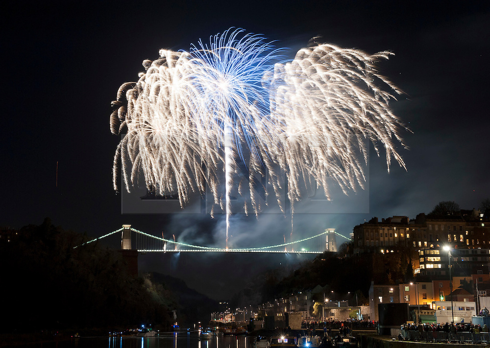 © Licensed to London News Pictures.  07/12/2014. Bristol, UK.  Fireworks for the150th anniversary of The Clifton Suspension Bridge, which spans the Avon Gorge from Bristol to Leigh Woods in North Somerset, and is the symbol of the city of Bristol was completed 150 years ago and first opened to the public on 8th December 1864.  The Grade I listed structure has attracted visitors from all over the world and was designed by Isambard Kingdom Brunel who won the competition to design a bridge to span the gorge, was begun in 1836 but was not completed until after his death.  The bridge is operated by Clifton Suspension Bridge Trust and is entirely funded by tolls - which have paid for its upkeep since it first opened to the public.  It is open and manned 24 hours a day, 7 days a week throughout the year and carries up to 12,000 vehicles crossing per day.  There will be a fireworks spectacular from the bridge on Sunday 07 December and a 150th anniversary procession on 08 December 2014.  Photo credit : Simon Chapman/LNP