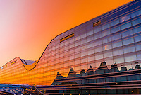 Westin Denver International Airport Hotel at sunrise, Denver, Colorado USA. The curved roof mimics the concave shape of the Jeppesen Terminal tents adjacent.