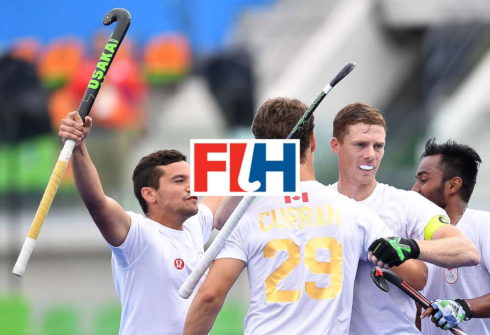 Canada's Scott Tupper (2nd R) celebrates scoring with his teammates during the mens's field hockey India vs Canada match of the Rio 2016 Olympics Games at the Olympic Hockey Centre in Rio de Janeiro on August, 12 2016.  / AFP / MANAN VATSYAYANA        (Photo credit should read MANAN VATSYAYANA/AFP/Getty Images)