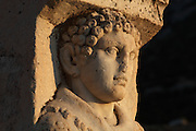 Head of Hercules from the Hercules Gate, 2nd century AD, on the East side of Curetes Street, Ephesus, Izmir, Turkey. The pillars, carved with representations of Hercules, were moved here in the 4th century AD to narrow the passage and block the street for wagon traffic. Above the pillars there was an arch with an inscription and Nike figure. Hercules, god of power and strength, is depicted carrying the skin of the Nemean lion, which he killed. Ephesus was an ancient Greek city founded in the 10th century BC, and later a major Roman city, on the Ionian coast near present day Selcuk. Picture by Manuel Cohen