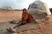 An old and sick Sudanese lady IDP (Internally displaced person) suffering from respiratory problems sits outside her shack in Muhajiriyah IDP camp home to more than 35 000 IDP's in the SLA (Sudan Liberation Army) controlled area of South Darfur, Sudan, Thursday 21 October 2004.<br /> <br /> UN secretary general Kofi Anan is appealing for donors to help urgently meet a shortfall of 200 million dollars needed for its humanitarian programme in war torn Darfur which has seen more than 1.5 million Sudanese people displaced.<br /> <br /> EPA PHOTO/NIC BOTHMA