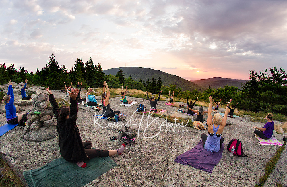 Kate Criscone from Body Design by Joy leads a sunrise yoga class from the top of Piper Mountain on Saturday morning.  (Karen Bobotas/for the Laconia Daily Sun)
