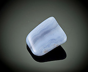Cutout of a blue lace agate gemstone on black background