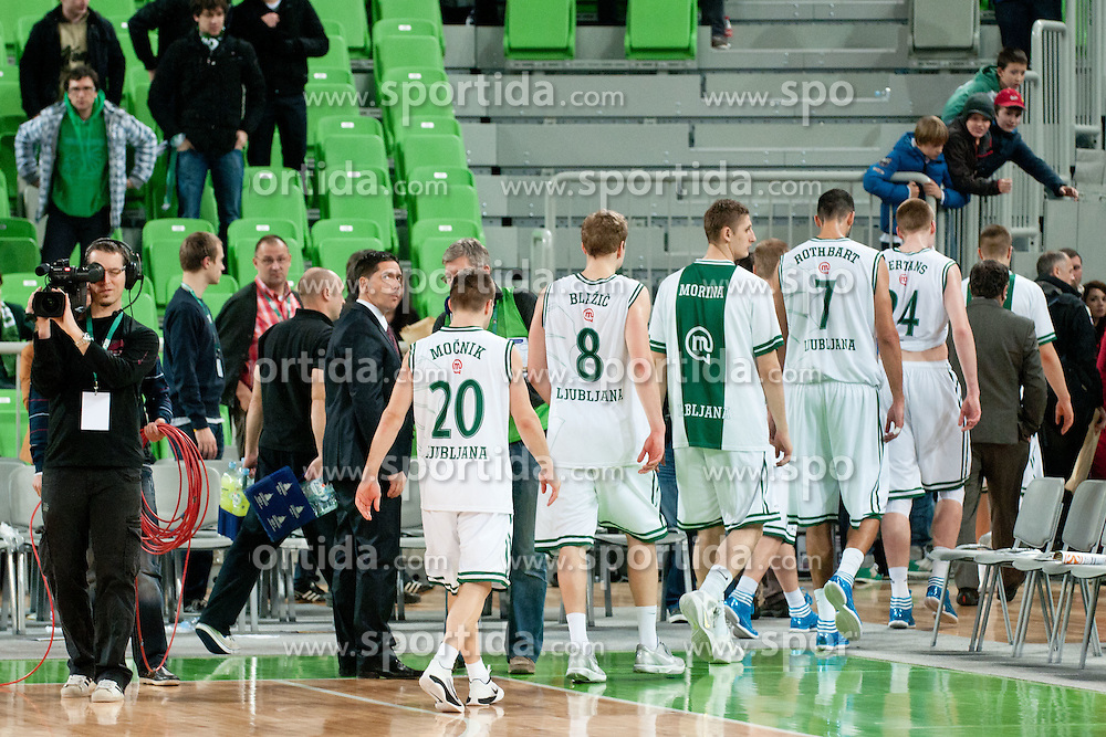 Team KK Union Olimpija leaving basketball court after basketball match between KK Union Olimpija and Unics Kazan (RUS) of 10th Round in Group D of Regular season of Euroleague 2011/2012 on December 21, 2011, in Arena Stozice, Ljubljana, Slovenia. Unics Kazan defeated Union Olimpija 76:63.(Photo by Matic Klansek Velej / Sportida)