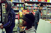 Teenage boys in a newsagents shop Lambeth Walk South London c.2000