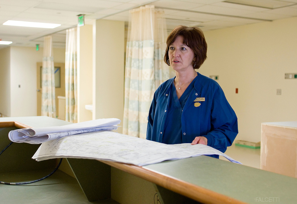 March 30, 2009:  Mary Campion, RN, CASC, Director of Nursing and GAPU manager at Naugatuck Valley Surgical Center, looks over the blueprints in the new Post Anesthesia Care Unit, still under construction.
