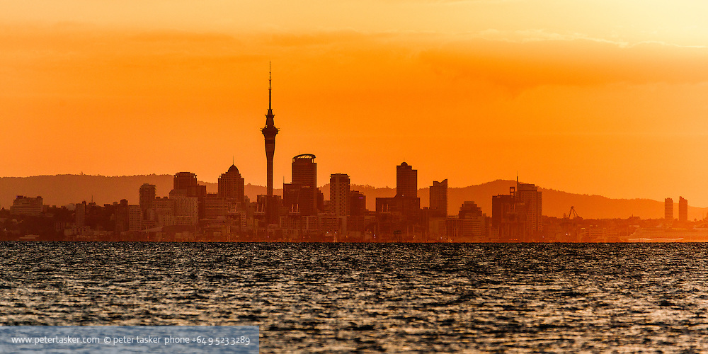 Sunset over Auckland CBD, as seen from Motuihe Island.