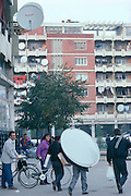 Albanians now have previously banned satellite dishes tuned to Italian stations they can't understand but watch to see the world.