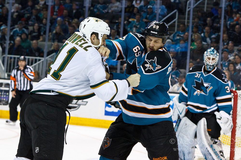 Mar 31, 2012; San Jose, CA, USA; Dallas Stars center Jake Dowell (11) fights San Jose Sharks center Andrew Desjardins (69) during the second period at HP Pavilion. San Jose defeated Dallas 3-0. Mandatory Credit: Jason O. Watson-US PRESSWIRE