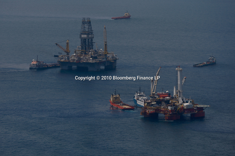 The Helix Energy, Q4000 platform and the Transocean Development Driller III rig leased by BP Plc which is drilling the primary relief well at the BP Plc Macondo well site in the Gulf of Mexico off the coast of Louisiana, U.S., on Saturday, August 7, 2010. BP successfully used the 'static kill', procedure  pumping mud into the top of the damaged well, BP plans now to finish a relief well to permanently plug the well by mid-August. Photographer: Derick E. Hingle/Bloomberg