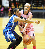 "Mississippi Lady Rebels guard Gracie Frizzell (12) passes around Kentucky Wildcats guard Jennifer O'Neill (0) at the C.M. ""Tad"" Smith Coliseum in Oxford, Miss. on Monday, February 23, 2015."