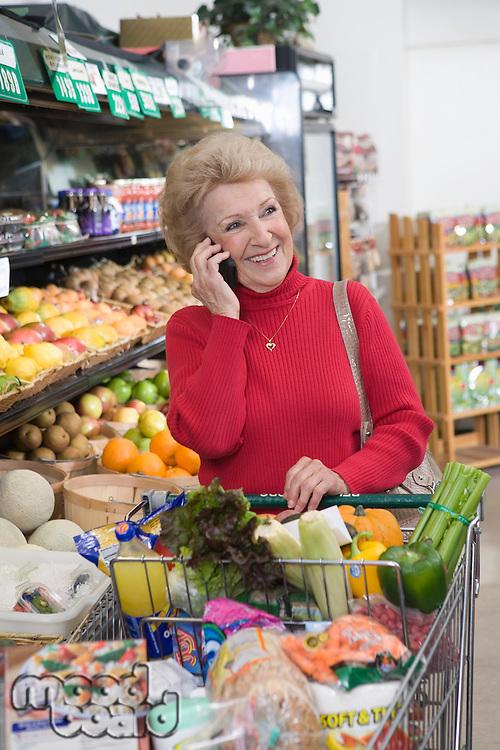 Senior woman grocery shopping