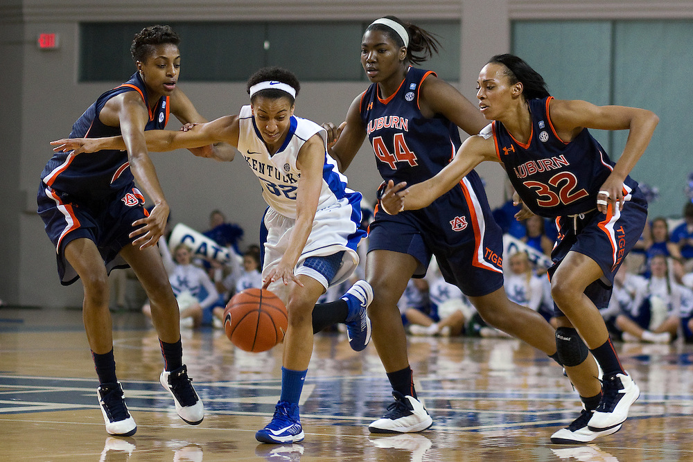 UK guard Kastine Evans, center, dribbles through three Auburn defenders in the first half. The University of Kentucky Women hosted Auburn University, Sunday, Jan. 20, 2013 at Memorial Coliseum in Lexington. Photo by Jonathan Palmer