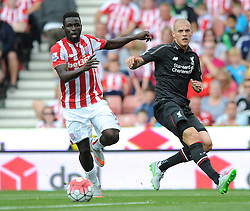 Mame Biram Diouf of Stoke City and Martin Skrtel of Liverpool - Mandatory byline: Dougie Allward/JMP - 07966386802 - 09/08/2015 - FOOTBALL - Britannia Stadium -Stoke-On-Trent,England - Stoke City v Liverpool - Barclays Premier League